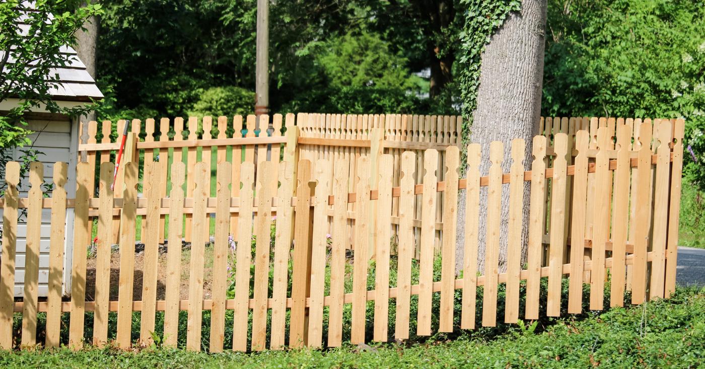 wood picket fenced in yard