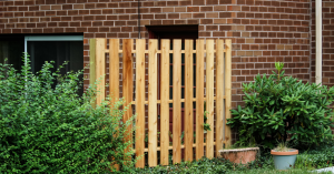 Backyard with small wood picket fence