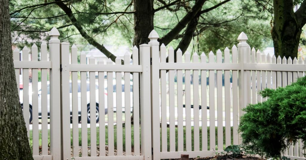 vinyl picket fence installed alongside gate