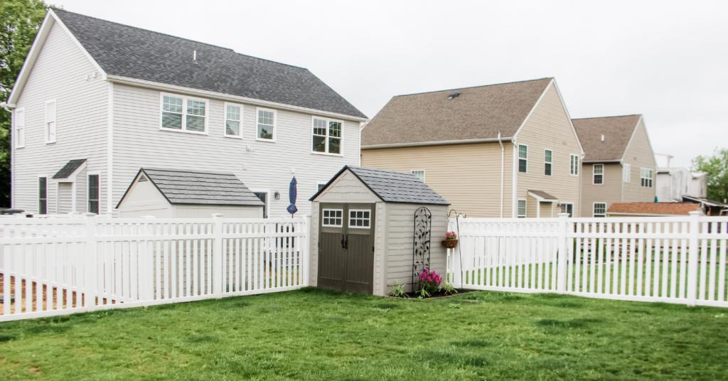 vinyl picket fence surrounding neighborhood