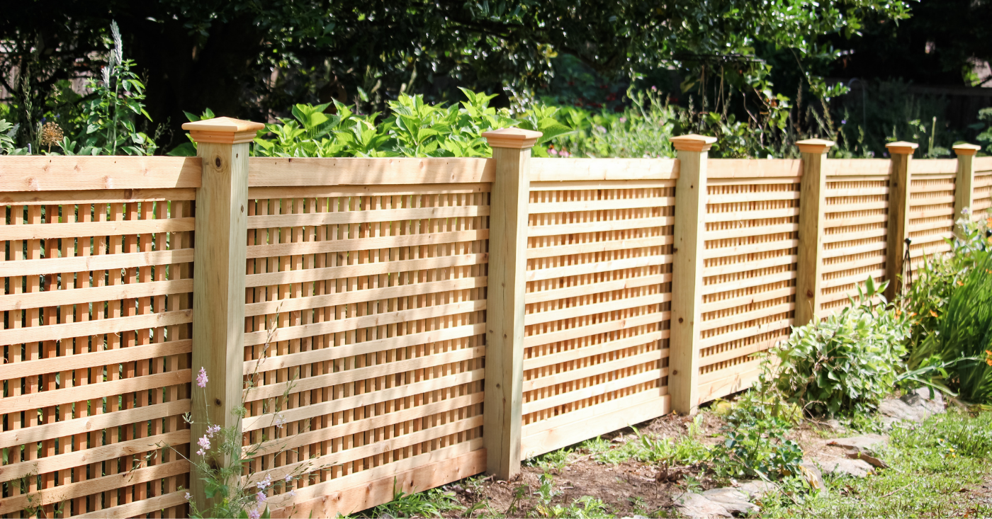 Wooden high fence protecting backyard