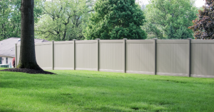 Tall fence surrounding backyard with seclusion