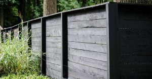 Modern black wooden fence for backyard privacy