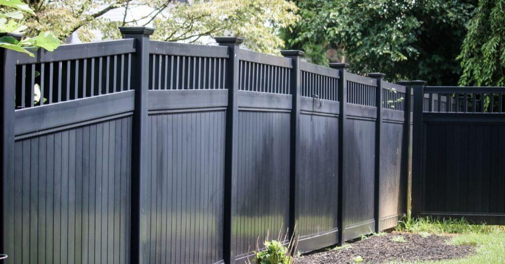 Modern black vinyl privacy fence