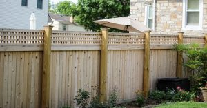 Wooden privacy fence providing total privacy for backyard