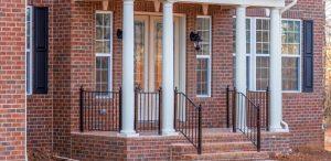 stylish black aluminum porch railing on new home build