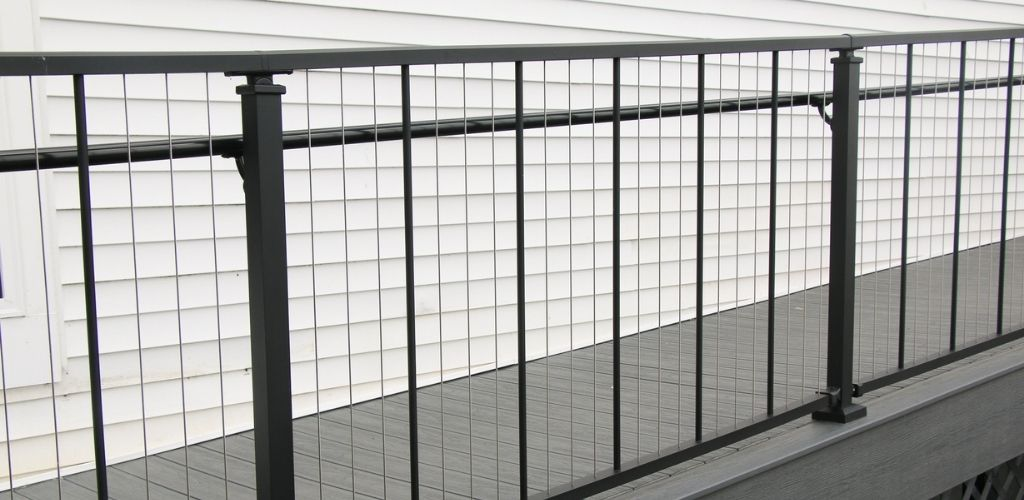 Aluminum railing with cable spindles on outdoor ramp